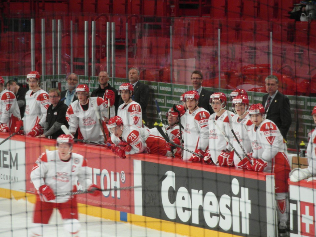 Denmark hockey team and coaches, From right to left, behind the bench, Per Bäckman, Tomas Jonsson and Esben Nedermark.
